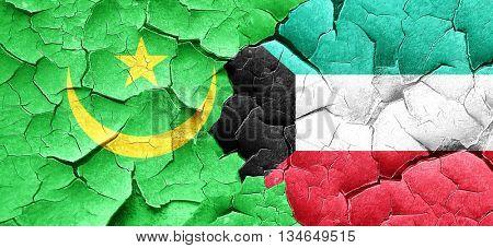 Mauritania flag with Kuwait flag on a grunge cracked wall