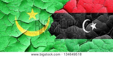 Mauritania flag with Libya flag on a grunge cracked wall