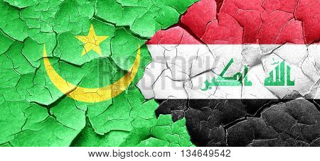 Mauritania flag with Iraq flag on a grunge cracked wall