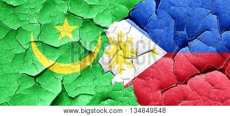 Mauritania flag with Philippines flag on a grunge cracked wall