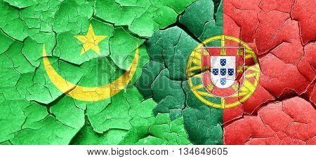 Mauritania flag with Portugal flag on a grunge cracked wall