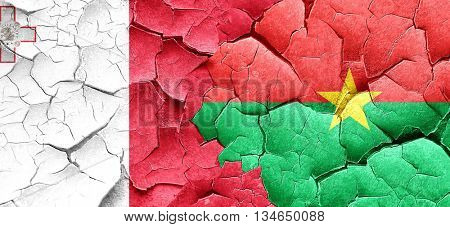 Malta flag with Burkina Faso flag on a grunge cracked wall