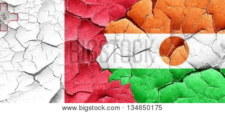 Malta flag with Niger flag on a grunge cracked wall