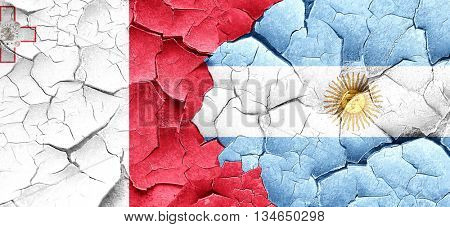 Malta flag with Argentine flag on a grunge cracked wall