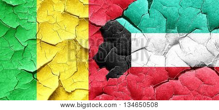 Mali flag with Kuwait flag on a grunge cracked wall