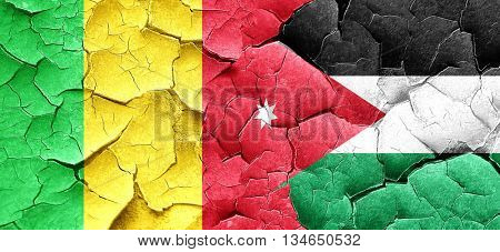 Mali flag with Jordan flag on a grunge cracked wall