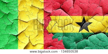 Mali flag with Ghana flag on a grunge cracked wall