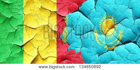 Mali flag with Kazakhstan flag on a grunge cracked wall
