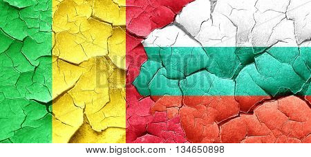 Mali flag with Bulgaria flag on a grunge cracked wall