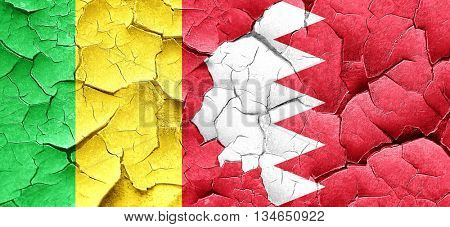 Mali flag with Bahrain flag on a grunge cracked wall