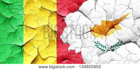 Mali flag with Cyprus flag on a grunge cracked wall