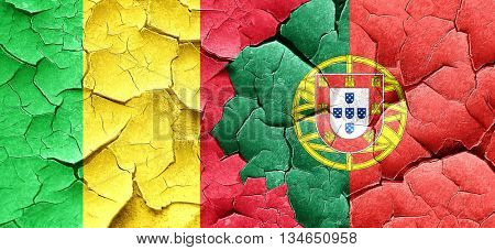Mali flag with Portugal flag on a grunge cracked wall