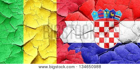 Mali flag with Croatia flag on a grunge cracked wall