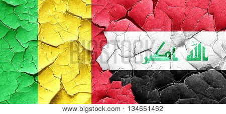 Mali flag with Iraq flag on a grunge cracked wall