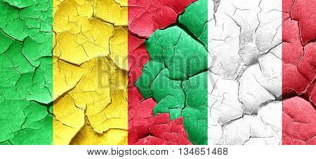 Mali flag with Italy flag on a grunge cracked wall