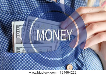 Money icon. Money in cotton shirt pocket, close up