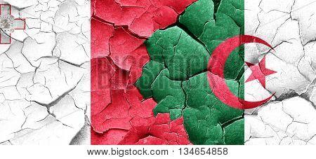 Malta flag with Algeria flag on a grunge cracked wall
