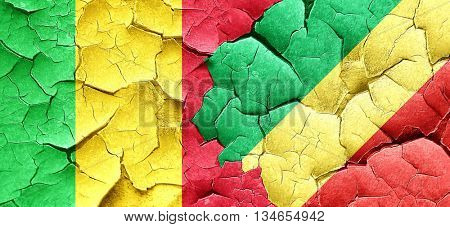 Mali flag with congo flag on a grunge cracked wall
