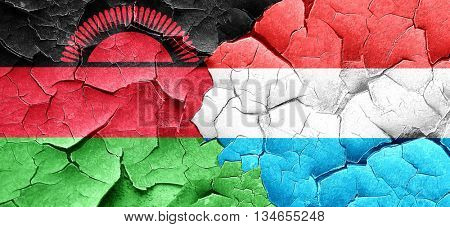 Malawi flag with Luxembourg flag on a grunge cracked wall