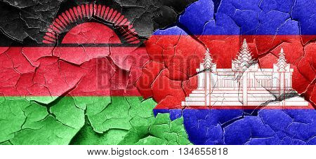 Malawi flag with Cambodia flag on a grunge cracked wall