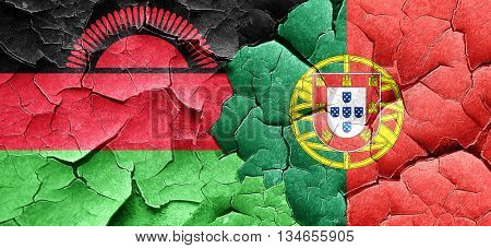 Malawi flag with Portugal flag on a grunge cracked wall