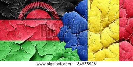 Malawi flag with Romania flag on a grunge cracked wall