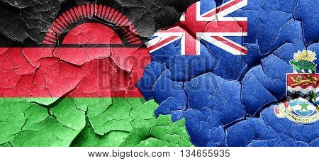Malawi flag with Cayman islands flag on a grunge cracked wall