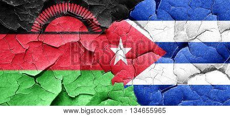 Malawi flag with cuba flag on a grunge cracked wall