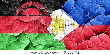 Malawi flag with Philippines flag on a grunge cracked wall