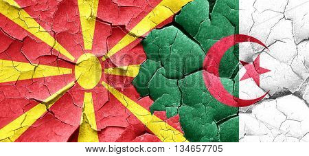 Macedonia flag with Algeria flag on a grunge cracked wall