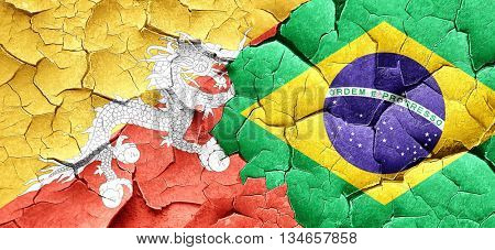 Bhutan flag with Brazil flag on a grunge cracked wall