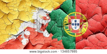 Bhutan flag with Portugal flag on a grunge cracked wall