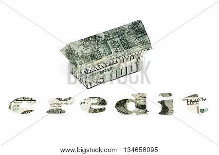 House origami of hundred dollar bills beside the text CREDIT carved out of dollars isolated on white background