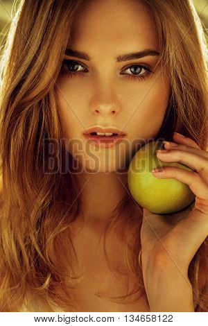 Picture Of Young Beautiful Woman With Green Apple