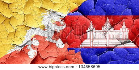 Bhutan flag with Cambodia flag on a grunge cracked wall