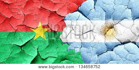 Burkina Faso flag with Argentine flag on a grunge cracked wall