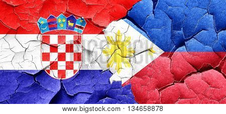 croatia flag with Philippines flag on a grunge cracked wall