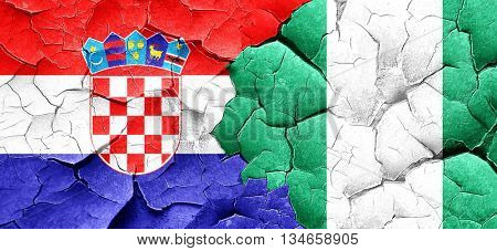 croatia flag with Nigeria flag on a grunge cracked wall