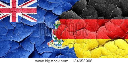 cayman islands flag with Germany flag on a grunge cracked wall