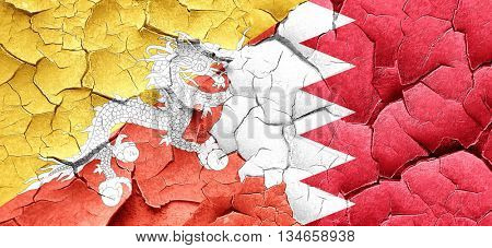 Bhutan flag with Bahrain flag on a grunge cracked wall