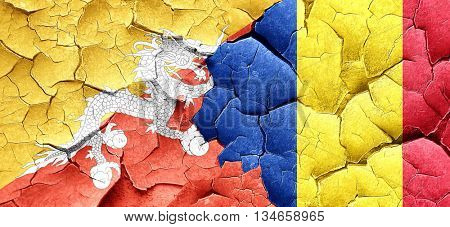 Bhutan flag with Romania flag on a grunge cracked wall