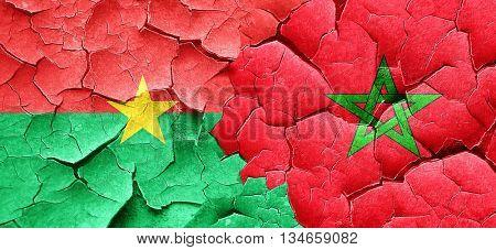 Burkina Faso flag with Morocco flag on a grunge cracked wall