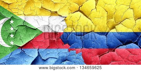 Comoros flag with Colombia flag on a grunge cracked wall