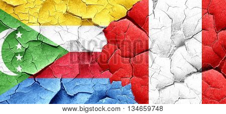 Comoros flag with Peru flag on a grunge cracked wall