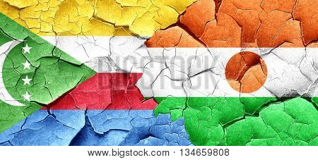 Comoros flag with Niger flag on a grunge cracked wall