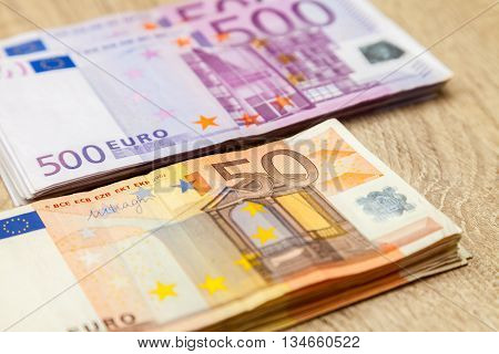 five hundred and fifty euro notes on table