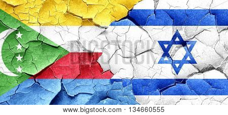 Comoros flag with Israel flag on a grunge cracked wall
