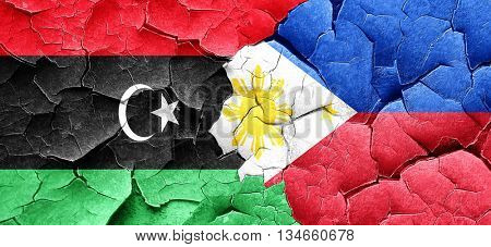 Libya flag with Philippines flag on a grunge cracked wall