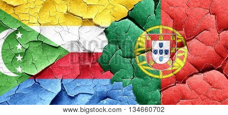 Comoros flag with Portugal flag on a grunge cracked wall