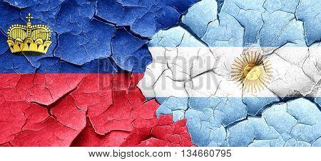 Liechtenstein flag with Argentine flag on a grunge cracked wall